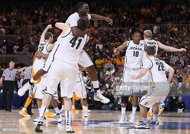 : : Draymond Green, Garrick Sherman and the res of the Michigan State Spartans celebrate the win over Tennessee during the midwest regional final of...