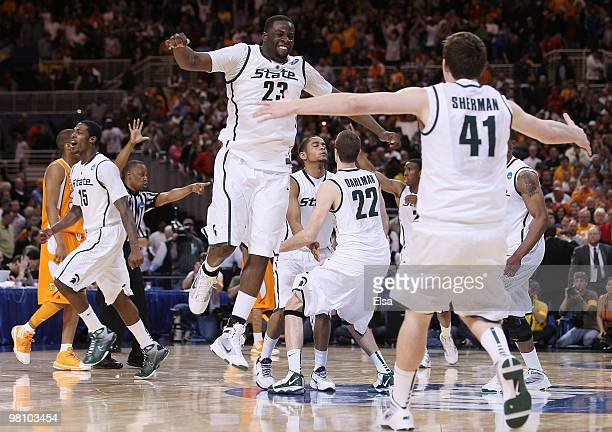 Draymond Green Garrick Sherman and the res of the Michigan State Spartans celebrate the win over Tennessee during the midwest regional final of the...