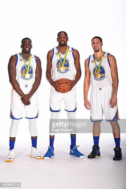 Draymond Green Kevin Durant and Klay Thompson of the Golden State Warriors poses for a portrait with their gold medals during NBA Media Day at Oracle...