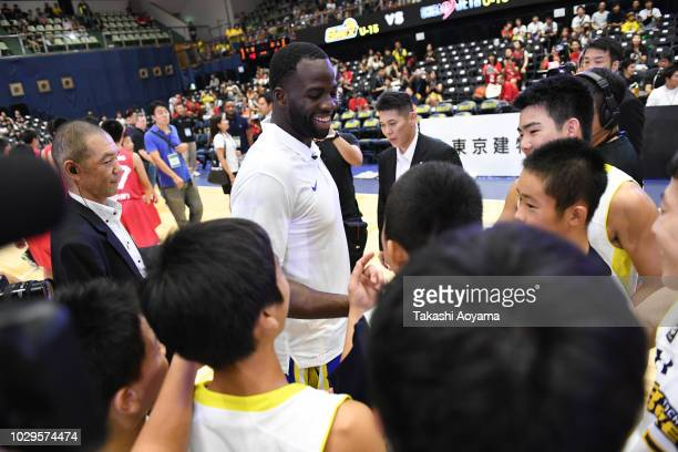 Draymond Green of Golden State Warriors greets players of Tochigi Brex U-15 during a fan Meeting event ahead of the B.League Early Cup Kanto 3rd...
