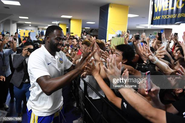 Draymond Green of Golden State Warriors high fives with fans during a fan Meeting event ahead of the B.League Early Cup Kanto 3rd Place Game between...