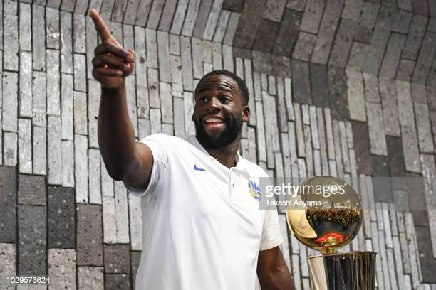 Draymond Green of Golden State Warriors poses for a photograph with The Larry O'Brien Championship Trophy during a fan Meeting event ahead of the...
