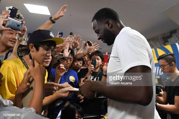 Draymond Green of Golden State Warriors signs autographs during a fan Meeting event ahead of the B.League Early Cup Kanto 3rd Place Game between...
