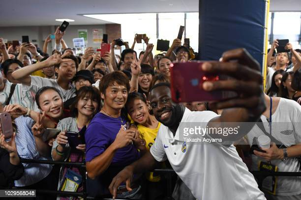 Draymond Green of Golden State Warriors takes a selfie with fans during a fan Meeting event ahead of the B.League Early Cup Kanto 3rd Place Game...