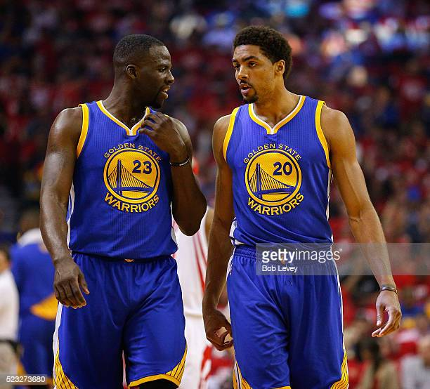 Draymond Green of the Golden State Warriors and James Michael McAdoo talk during the second half against the Houston Rockets at Toyota Center on...