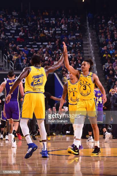 Draymond Green of the Golden State Warriors and Jordan Poole of the Golden State Warriors highfive during a game against the Los Angeles Lakers on...