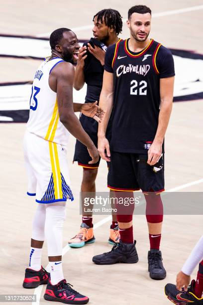 Draymond Green of the Golden State Warriors and Larry Nance Jr. #22 of the Cleveland Cavaliers interact after the game at Rocket Mortgage Fieldhouse...