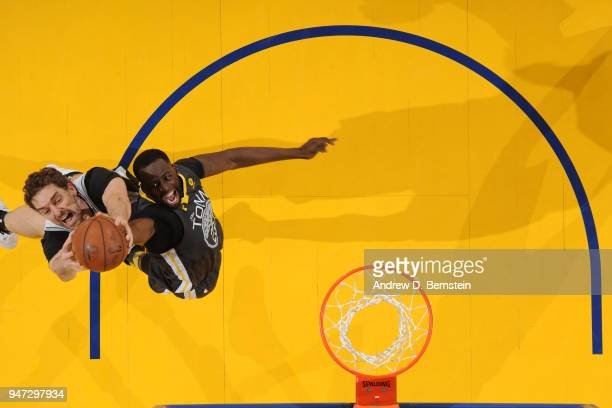 Draymond Green of the Golden State Warriors and Pau Gasol of the San Antonio Spurs jump for the rebound in Game Two of Round One of the 2018 NBA...
