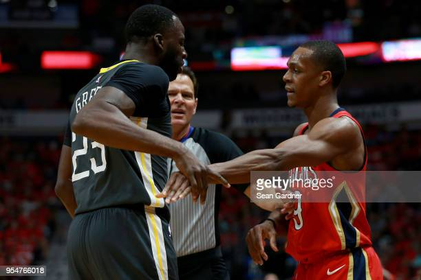 Draymond Green of the Golden State Warriors and Rajon Rondo of the New Orleans Pelicans are involved in an altercation during the first half of Game...