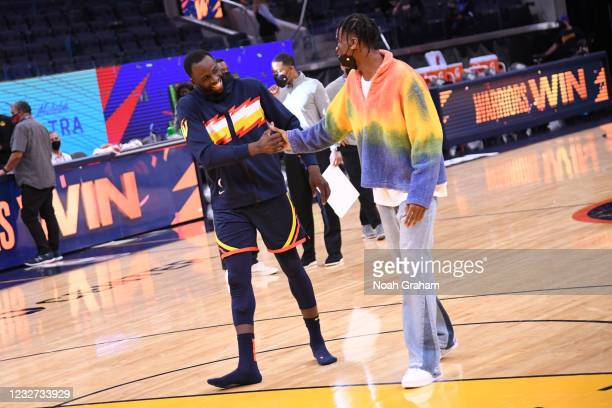 Draymond Green of the Golden State Warriors and Shai Gilgeous-Alexander of the Oklahoma City Thunder talk after the game on May 6, 2021 at Chase...