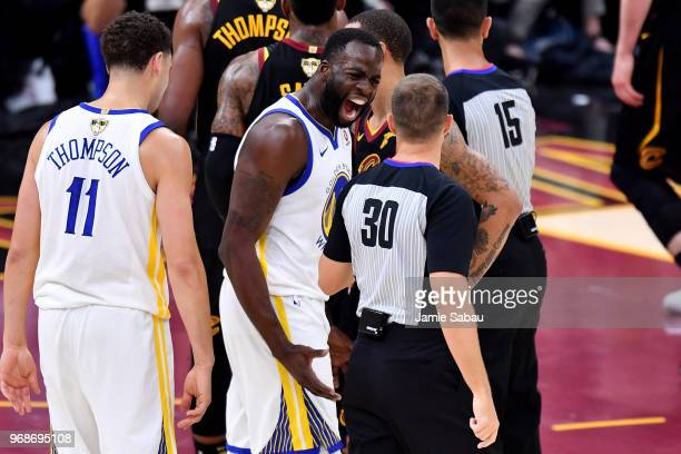 Draymond Green of the Golden State Warriors argues with referee John Goble after a foul call in the first quarter against the Cleveland Cavaliers...