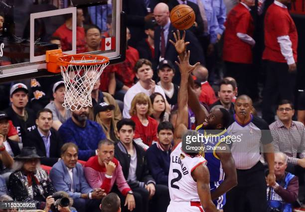 Draymond Green of the Golden State Warriors attempts a shot against Kawhi Leonard of the Toronto Raptors in the first half during Game Two of the...