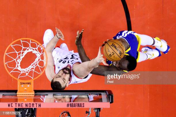Draymond Green of the Golden State Warriors attempts a shot against Marc Gasol of the Toronto Raptors during Game Five of the 2019 NBA Finals at...