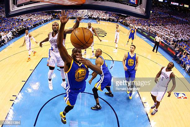 Draymond Green of the Golden State Warriors attempts to rebound against the Oklahoma City Thunder in game three of the Western Conference Finals...