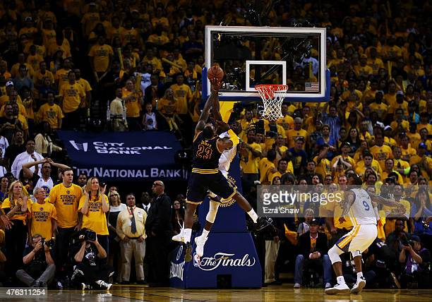 Draymond Green of the Golden State Warriors blocks a shot by LeBron James of the Cleveland Cavaliers in overtime during Game Two of the 2015 NBA...