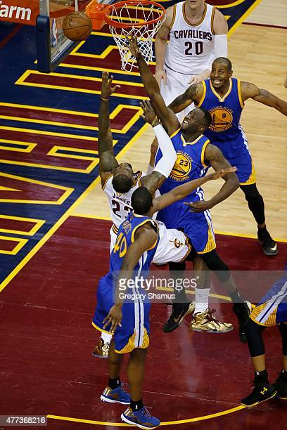 Draymond Green of the Golden State Warriors blocks the ball against LeBron James of the Cleveland Cavaliers during Game Six of the 2015 NBA Finals at...