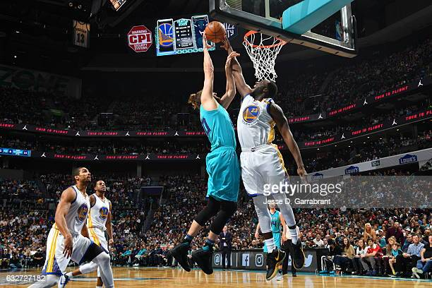 Draymond Green of the Golden State Warriors blocks the shot against the Charlotte Hornets at Spectrum Center on January 25 2017 in Charlotte North...