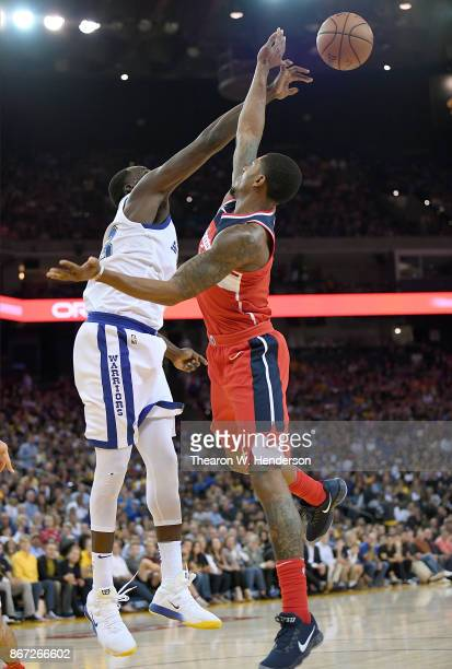 Draymond Green of the Golden State Warriors blocks the shot of Bradley Beal of the Washington Wizards during the second quarter of their NBA...