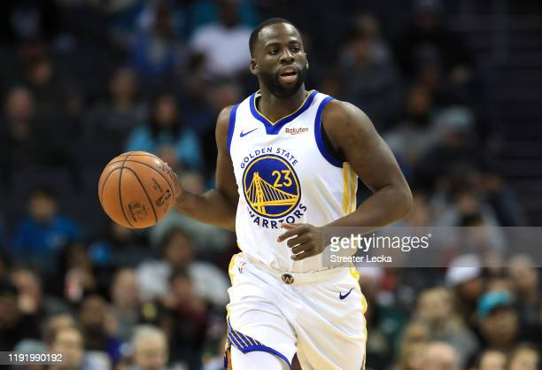 Draymond Green of the Golden State Warriors brings the ball up the court against the Charlotte Hornets during their game at Spectrum Center on...