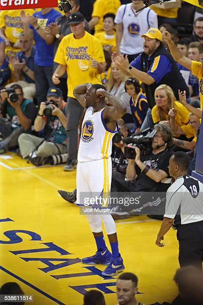 Draymond Green of the Golden State Warriors celebartes by flexing during Game Two of the 2016 NBA Finals against the Cleveland Cavaliers on June 5...