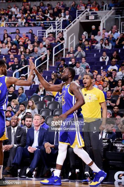 Draymond Green of the Golden State Warriors celebrates during the game against the Phoenix Suns on February 12 2020 at Talking Stick Resort Arena in...