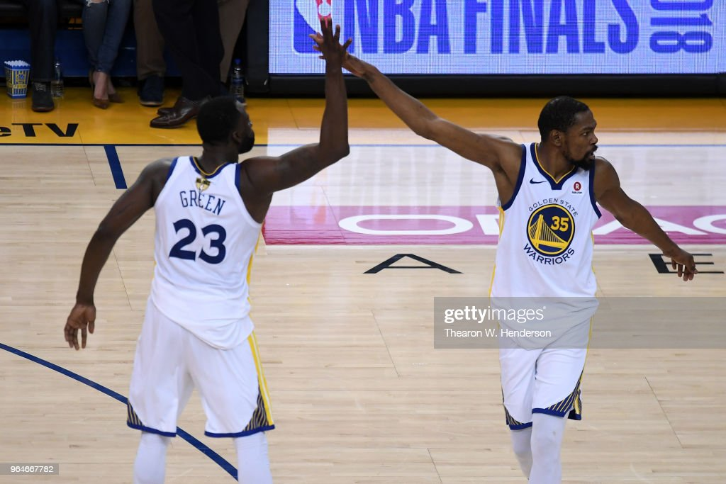 Draymond Green #23 of the Golden State Warriors celebrates with Kevin Durant #35 against the Cleveland Cavaliers in overtime during Game 1 of the 2018 NBA Finals at ORACLE Arena on May 31, 2018 in Oakland, California.