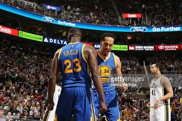 Draymond Green of the Golden State Warriors celebrates with Shaun Livingston of the Golden State Warriors during the game against the Utah Jazz on...