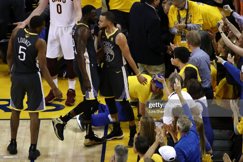 Draymond Green #23 of the Golden State Warriors celebrates with Stephen Curry #30 against the Cleveland Cavaliers in Game 2 of the 2018 NBA Finals at ORACLE Arena on June 3, 2018 in Oakland, California.
