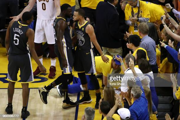 Draymond Green of the Golden State Warriors celebrates with Stephen Curry against the Cleveland Cavaliers in Game 2 of the 2018 NBA Finals at ORACLE...