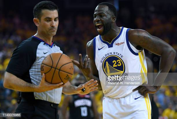 Draymond Green of the Golden State Warriors complains over a technical foul call on him by referee Zach Zarba against the Houston Rockets during Game...