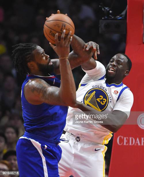 Draymond Green of the Golden State Warriors defends a shot by DeAndre Jordan of the Los Angeles Clippers in the second half of the game on January 6...