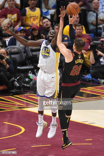 Draymond Green of the Golden State Warriors defends a shot by Kyle Korver of the Cleveland Cavaliers during Game Four of the 2018 NBA Finals at...