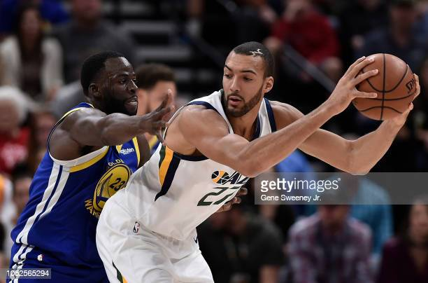 Draymond Green of the Golden State Warriors defends against Rudy Gobert of the Utah Jazz in the first half of a NBA game at Vivint Smart Home Arena...