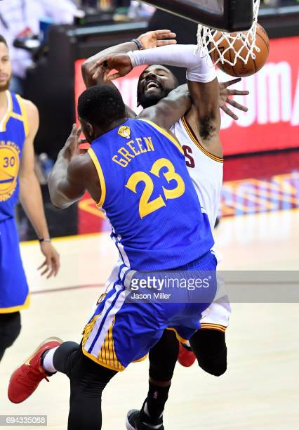 Draymond Green of the Golden State Warriors defends Kyrie Irving of the Cleveland Cavaliers in the first quarter in Game 4 of the 2017 NBA Finals at...