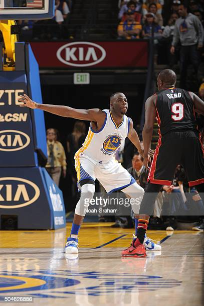 Draymond Green of the Golden State Warriors defends Luol Deng of the Miami Heat on January 11 2016 at Oracle Arena in Oakland California NOTE TO USER...