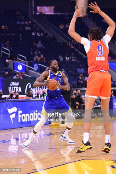 Draymond Green of the Golden State Warriors dribbles during the game against the Oklahoma City Thunder on April 8, 2021 at Chase Center in San...