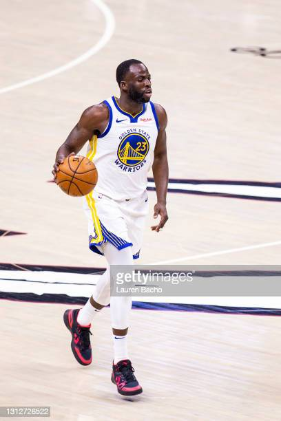Draymond Green of the Golden State Warriors dribbles the ball down the court during the third quarter of a game against the Cleveland Cavaliers at...
