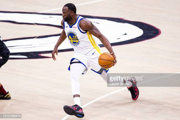 Draymond Green of the Golden State Warriors dribbles the ball down the court during the fourth quarter of a game against the Cleveland Cavaliers at...