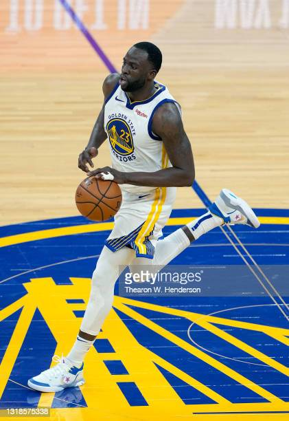 Draymond Green of the Golden State Warriors dribbles the ball up court against the Memphis Grizzlies during the second half of an NBA basketball game...