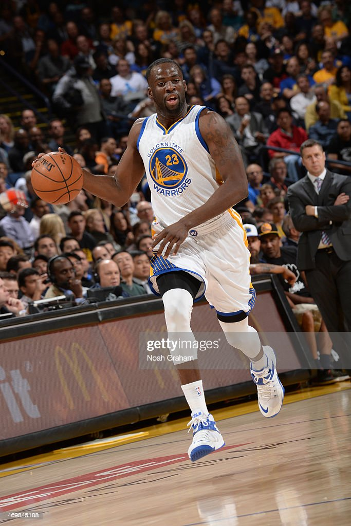Draymond Green #23 of the Golden State Warriors drives against Kosta Koufos #41 of the Memphis Grizzlies on April 13, 2015 at Oracle Arena in Oakland, California.