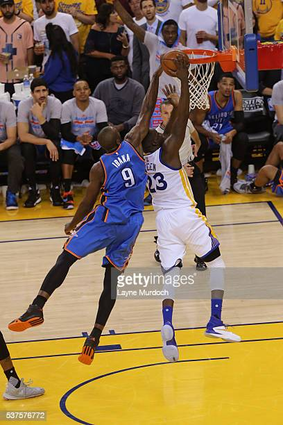 Draymond Green of the Golden State Warriors drives to the basket while guarded by Serge Ibaka of the Oklahoma City Thunder in Game Five of the...