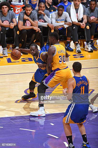 Draymond Green of the Golden State Warriors drives to the basket while guarded by Julius Randle of the Los Angeles Lakers on November 4 2016 at...