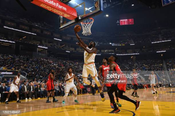 Draymond Green of the Golden State Warriors drives to the basket against the Houston Rockets on February 20 2020 at Chase Center in San Francisco...