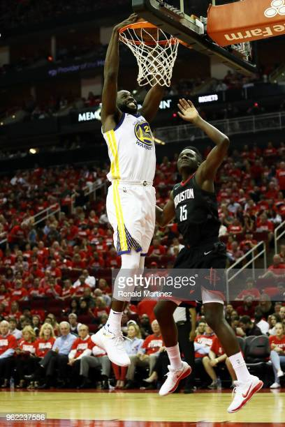 Draymond Green of the Golden State Warriors dunks against Clint Capela of the Houston Rockets in the third quarter of Game Five of the Western...