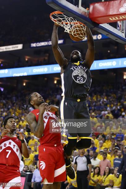 Draymond Green of the Golden State Warriors dunks the ball against the Toronto Raptors in the first half during Game Six of the 2019 NBA Finals at...