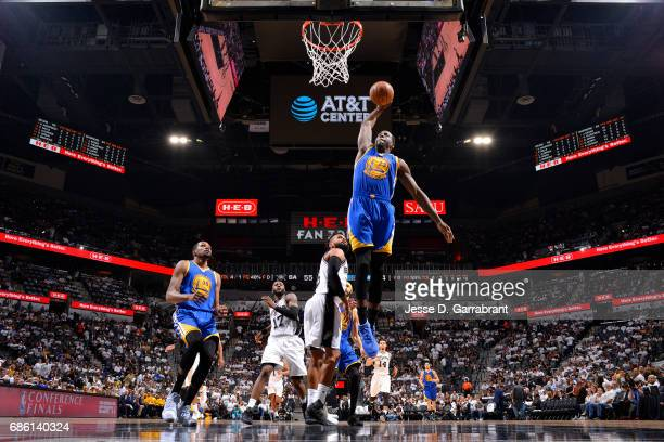 Draymond Green of the Golden State Warriors dunks the ball during the game against the San Antonio Spurs during Game Three of the Western Conference...