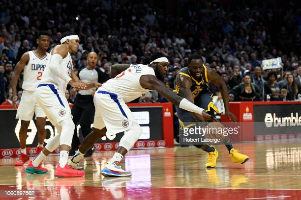 Draymond Green of the Golden State Warriors fights for the ball against Montrezl Harrell of the Los Angeles Clippers on November 12 2018 at STAPLES...