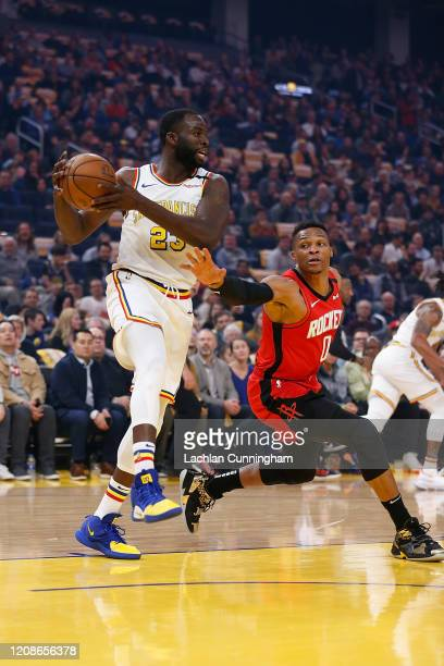Draymond Green of the Golden State Warriors gets a rebound against Russell Westbrook of the Houston Rockets in the first half at Chase Center on...