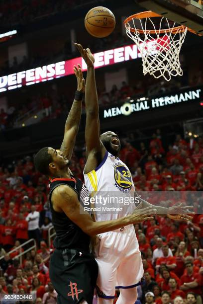 Draymond Green of the Golden State Warriors goes up against Trevor Ariza of the Houston Rockets in the third quarter of Game Seven of the Western...