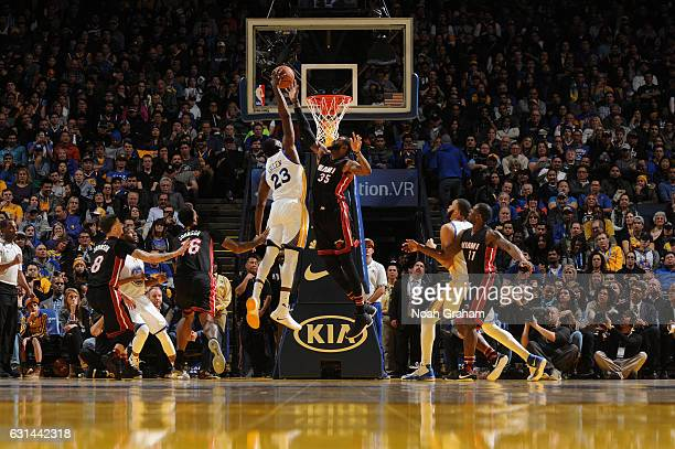 Draymond Green of the Golden State Warriors goes up for a dunk during a game against the Miami Heat on January 10 2017 at ORACLE Arena in Oakland...